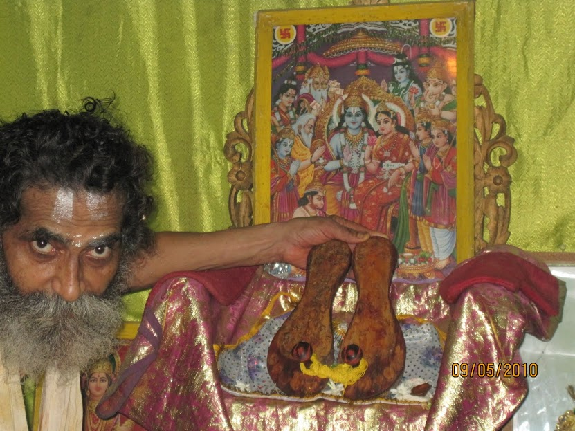 priest showing Rama paduka.jpg